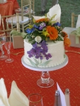 Cake centerpiece with floral topper