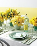 mint plates and yellow flowers